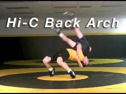 High Crotch to Back Arch KOLAT.COM Wrestling Move Technique Instruction Image 1