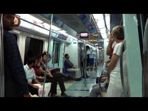 Inside the Dubai Metro train with station announcement