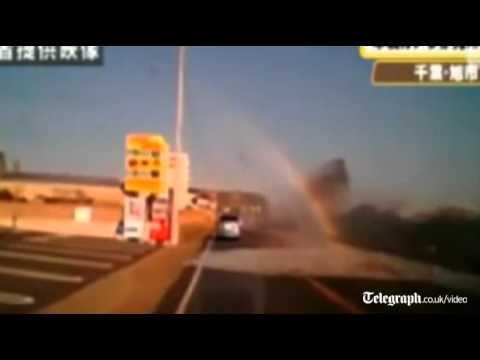 Car Engulfed by Tsunami