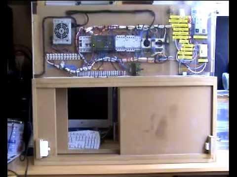 Automatismo para el control de una puerta de garaje: El Todo