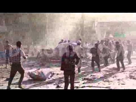 Barrel bomb kills scores at a busy market in Aleppo, Syria