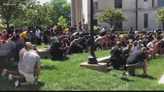 Mizzou football joins together for peaceful protest, then marches to courthouse to register to vote