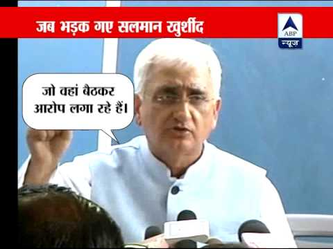 Salman Khurshid denies charges, has spat with reporters