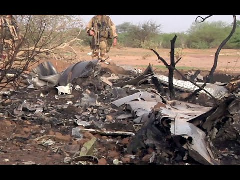 French soldiers secured a black box from the Air Algerie wreckage site in a desolate region of restive northern Mali on Friday, the French president said. Terrorism hasn\'t been ruled out as a cause, although officials say the most likely reason for the catastrophe that killed all onboard is bad weather.   At least 116 people were killed in Thursday\'s disaster, nearly half of whom were French. President Francois Hollande put the number of victims at 118, a discrepancy that couldn\'t be immediately clarified.   One of two black boxes was recovered from the wreckage in the Gossi region of Mali near the border with Burkina Faso, and was taken to the northern city of Gao, where a French contingent is based, Hollande told reporters after an emergency meeting with government ministers.   \