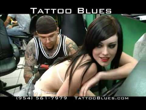 Women in bikinis invade Tattoo Blues in Ft. Lauderdale, Florida!
