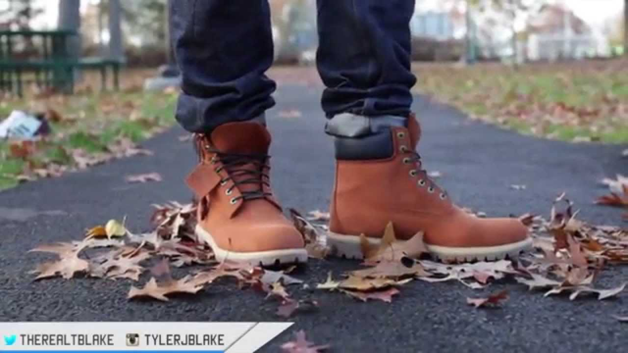 all black timberland boots on feet