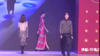 Model in very high heels falls down 3 times during a Chinese fashion show