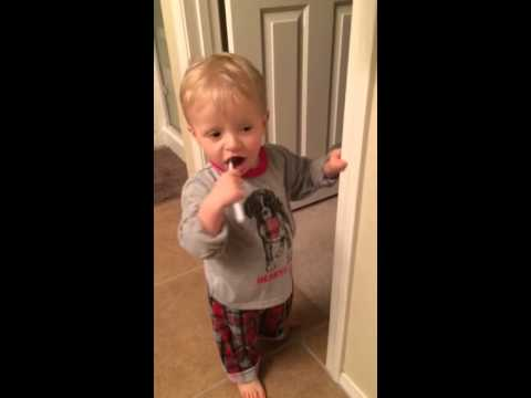 Cayden brushing his teeth.