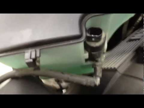 How to install a headlight bulb in a bmw X3 on the passenger side x5