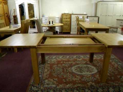 Shaker style Extending oak table with dual action runners