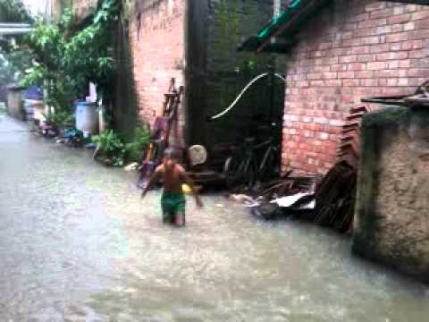 Slum Boy Playing With Store Water Due To Heavy Rain.....