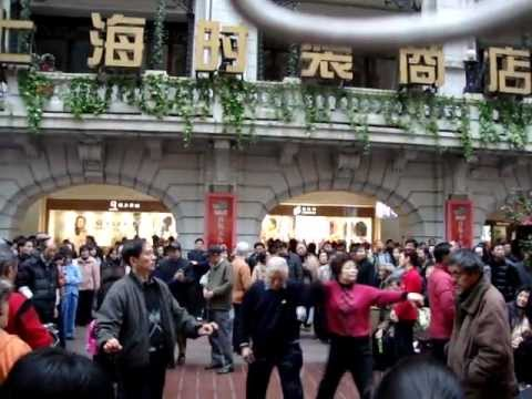 TRUMPET PLAYING AT PEOPLE SQUARE NANJING STREET SHANGHAI