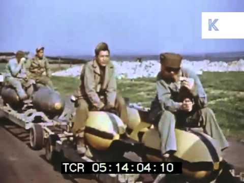 1930s, 1940s Soldier Sitting on Missile Playing Harmonica, WWII Colour Footage