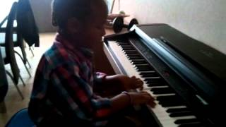Omarly playing piano
