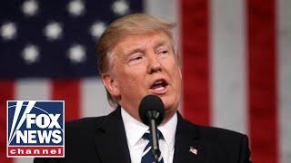 Trump participates in a flag presentation ceremony