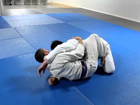 Flowing BJJ drill for Side Control sweep at Evolution Training in Houma Image 1