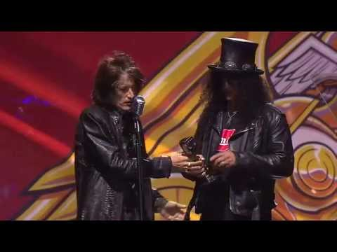Slash receives the APMAs Guitar Legend Award, introduced by Aerosmith's Joe Perry