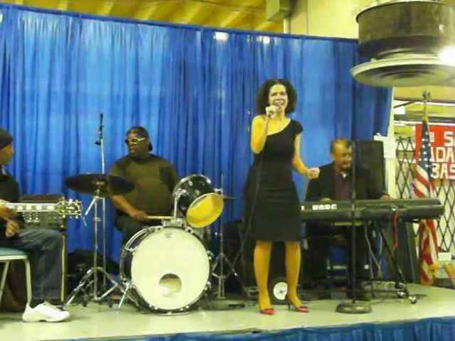 Natasha DaVias singing Whitney Houston's Saving all my love for you