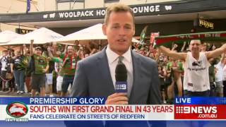 Rabbitohs fan flashes during Channel Nine News live cross