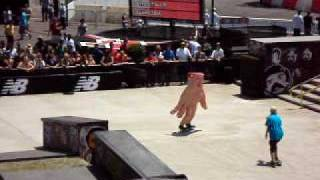 Giant hand costume skateboarding at x games