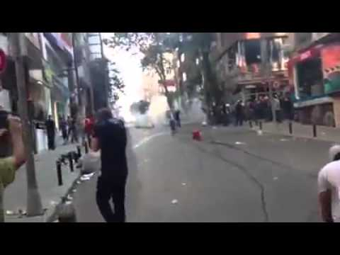 Protesters neutralizing teargas canisters Istanbul, Turkey