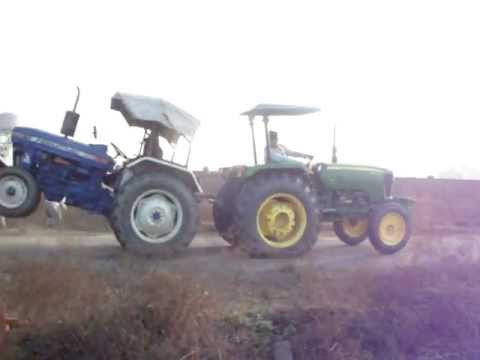 john deere 5060 vs. farmtrac 60.AVI