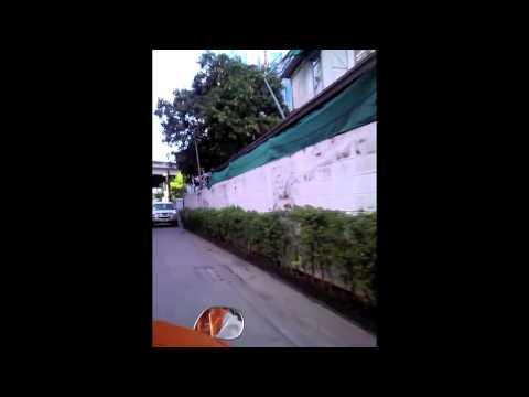 Riding a motorcycle taxi in Bangkok