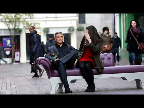 george clooney on bench in carnaby street - waxword gets a kiss before valentine's day