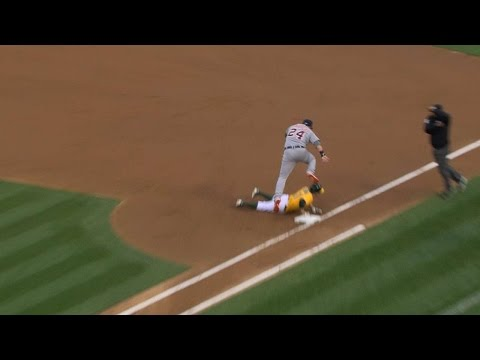 Miggy tries to deke the runner to no avail