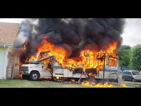 Early video: RV and SUV fire threaten Ill. home