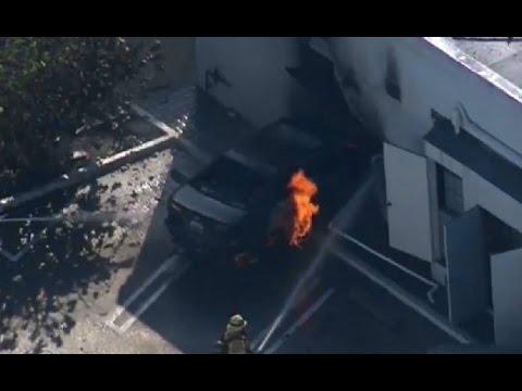 Car crashes into Santa Monica building, catches fire