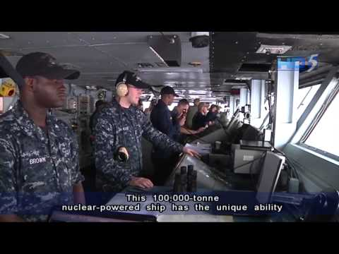 USS John C Stennis sails home after stopping by Singapore - 07Apr2013