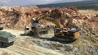 Cat 385C Excavator Loading Trucks