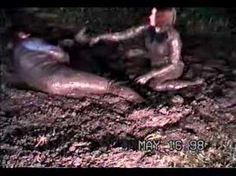 Mud wrestling with 3rd ex wife, in beavertail wetsuits Video