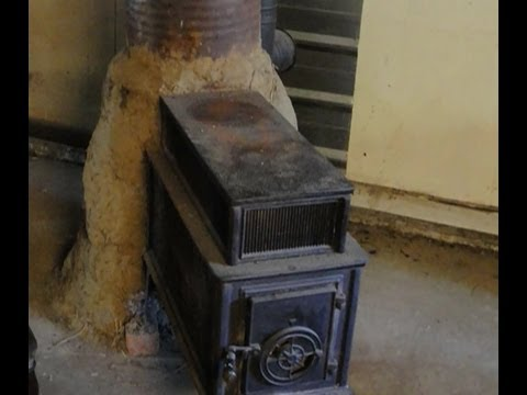 wood stove + rocket mass heater = hybrid