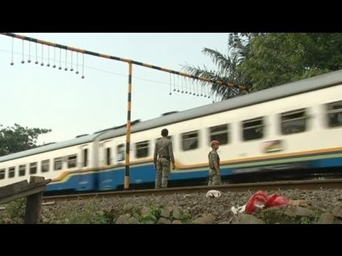 Concrete balls threaten Indonesia train 'surfers' - no comment