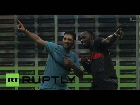 India: See Usain Bolt's breakneck ball skills stump Yuvraj Singh in Bangalore