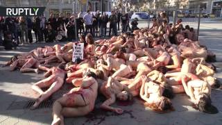 Caged, bloody & naked, animal rights activists decry fur industry in Barcelona (Explicit)