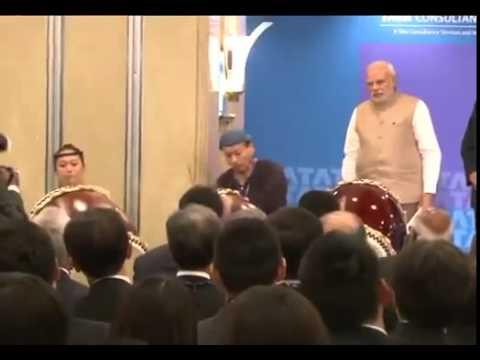 Narendra Modi playing drums during Japan visit