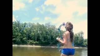 Girl is hunting fish with a bow!