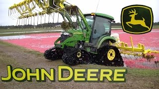John Deere 4520 with Soucy Tracks Knocking Off Cranberries