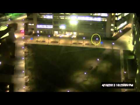Surveillance video shows two people approaching MIT officer's cruiser