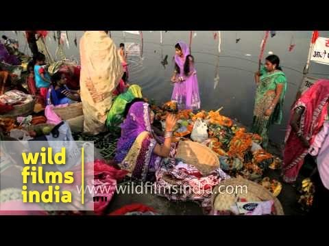 Devotees gather on bank of river Yamuna during Chhath puja