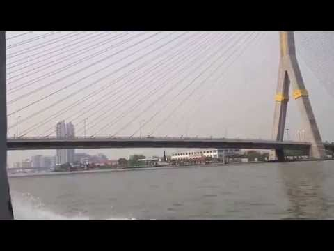 Taking water taxi along Chao Phraya River in Bangkok