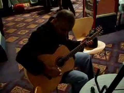 Russell Malone plays DMG002, baritone acoustic guitar.