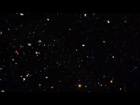 Zoom into GOODS field containing distant dwarf galaxies forming stars at an incredible rate