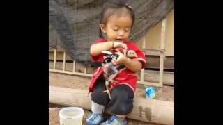 Little Girl Washes Bird