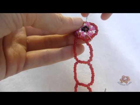 Посмотреть ролик - Розовый браслет из бисера как плести браслеты из розового бисера.