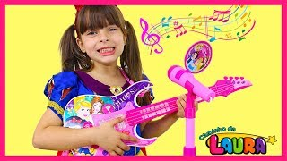 LAURINHA PLAYS WITH DISNEY PRINCESS TOY GUITAR MAGIC AND STARS A BAND