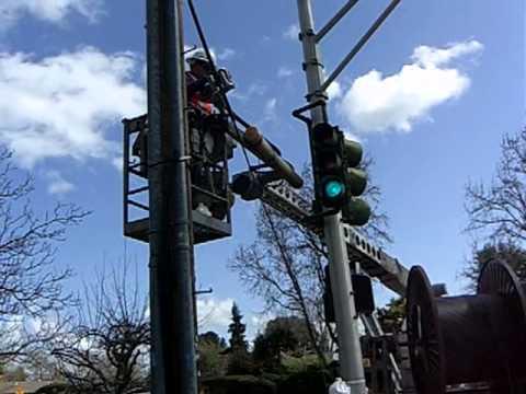 At Amp T U Verse Team Pulls Fiber Cable Via Hanging Conduit